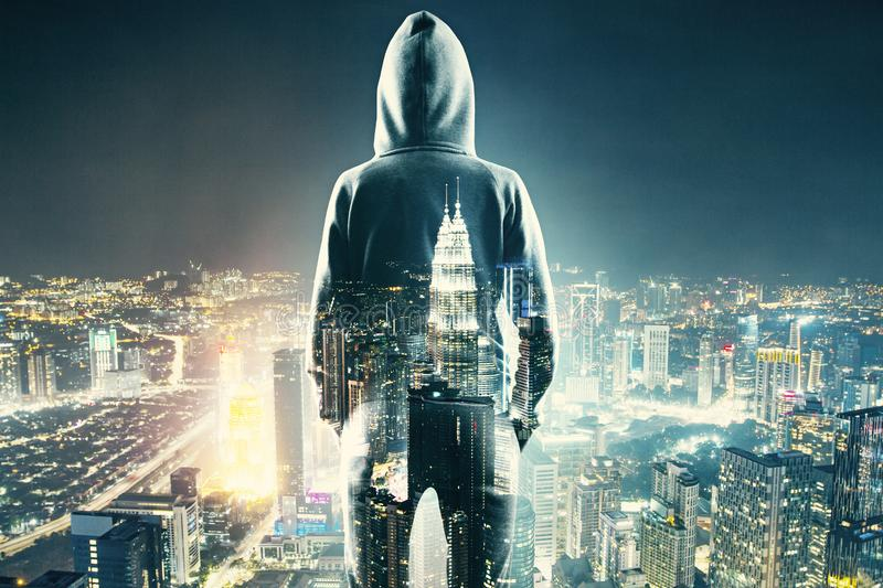 Guy-In-Hoodie-Looking-Over-Cityscape