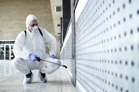 Man-In-Tyvek-Suit-Cleaning-Up-A-Contaminated-Room