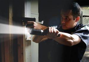 Officer-Holding-a-Flashlight
