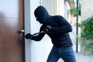 Thief-With-A-Iron-Bar-On-A-Door