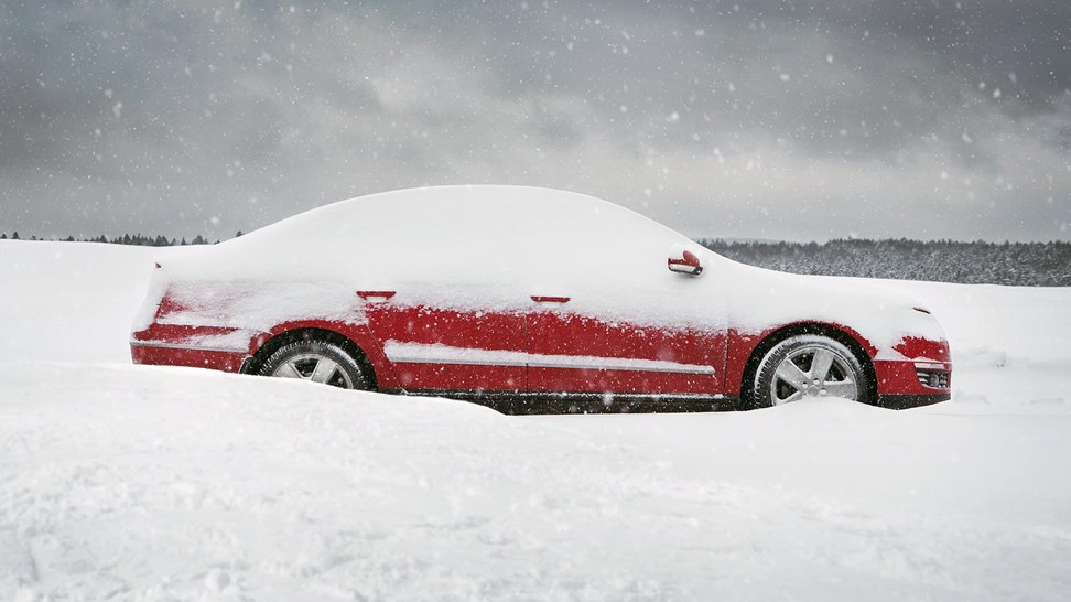 car-stuck-in-snowy-road