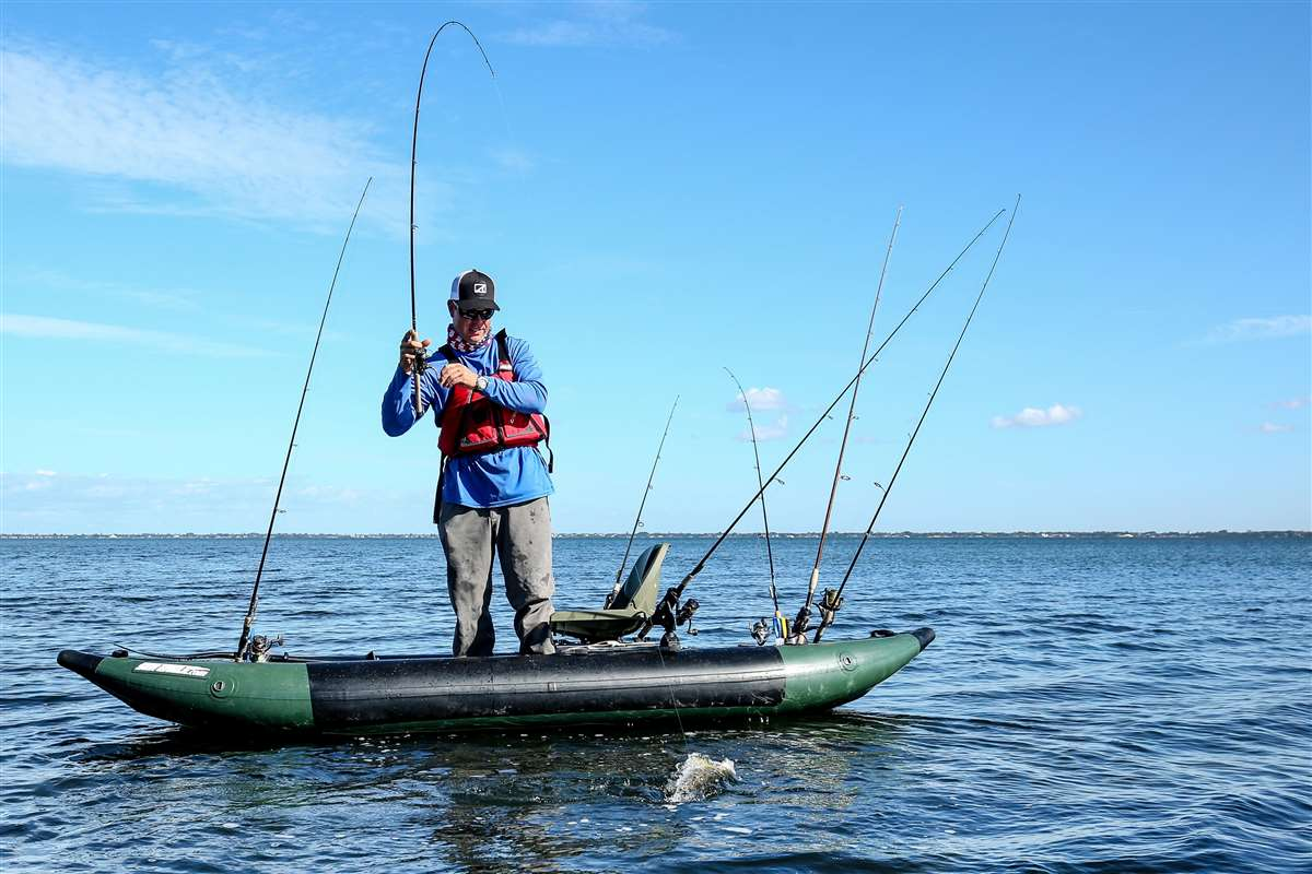 Man-Fighting-Fish-In-Inflatable-Boat